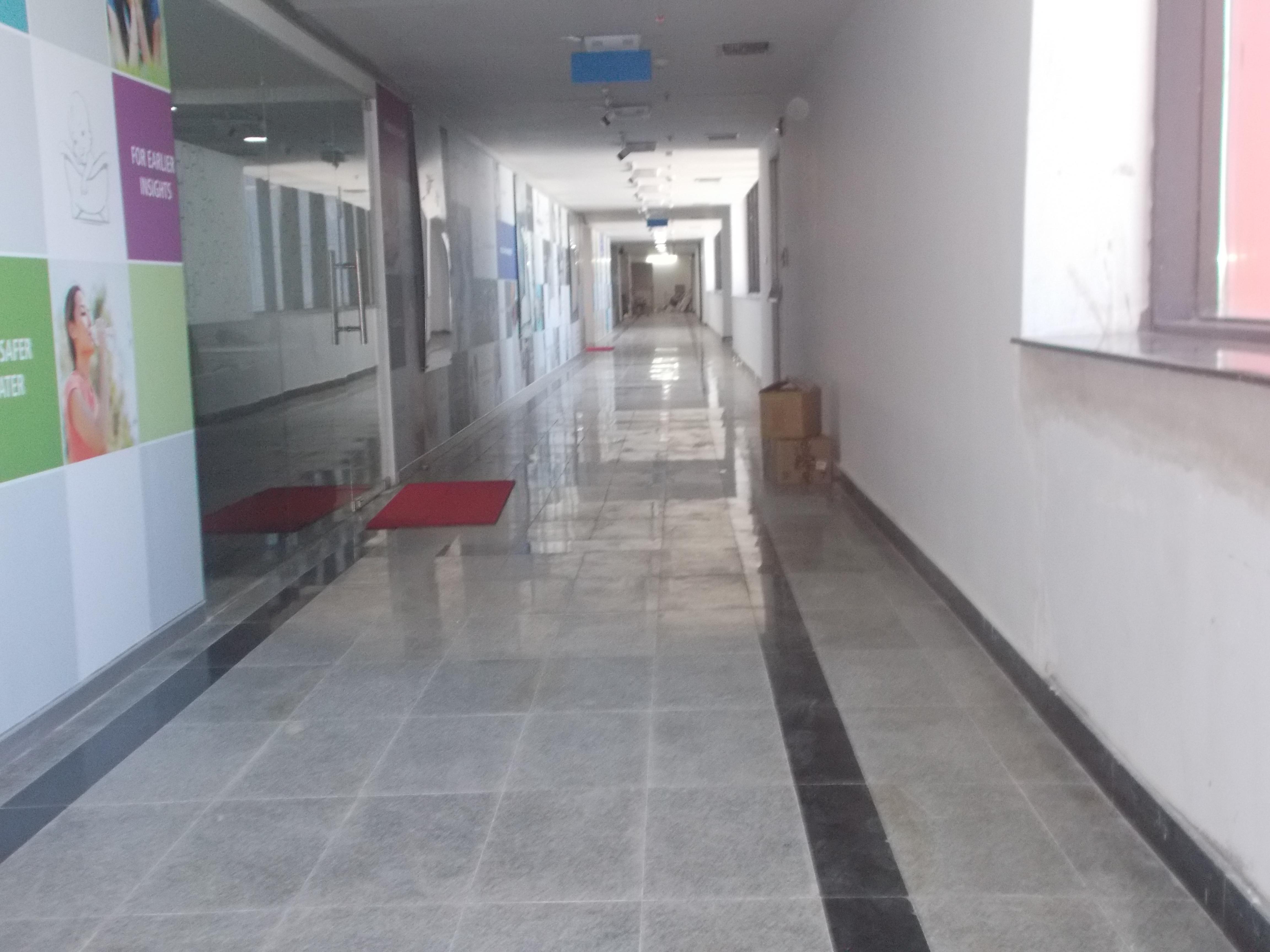 10. Corridor granite tile flooring